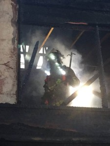 A Contra Costa County Fire Protection District firefighter working a May 31, 2016, apartment fire. (ConFire)