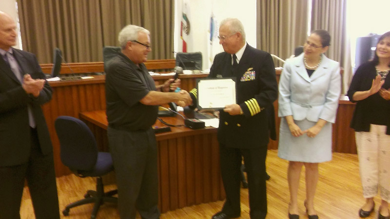 Mayor Rob Schroder (far left) presents a Certificate of Recognition to Capt. Ingemar Olsson, U.S. Merchant Marine (center), during the July 20, 2016, meeting of the Martinez City Council. Looking on is Councilwoman Anamarie Avila Farias. (TIM TUCKER / Courtesy)