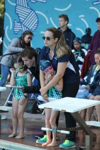 Coaches Nate Madsen (second from left) and Courtney Butler prepare Matilda Davoren (far left) and Maddie McKeown for their race. (LAUREL PUREWAL / Courtesy)