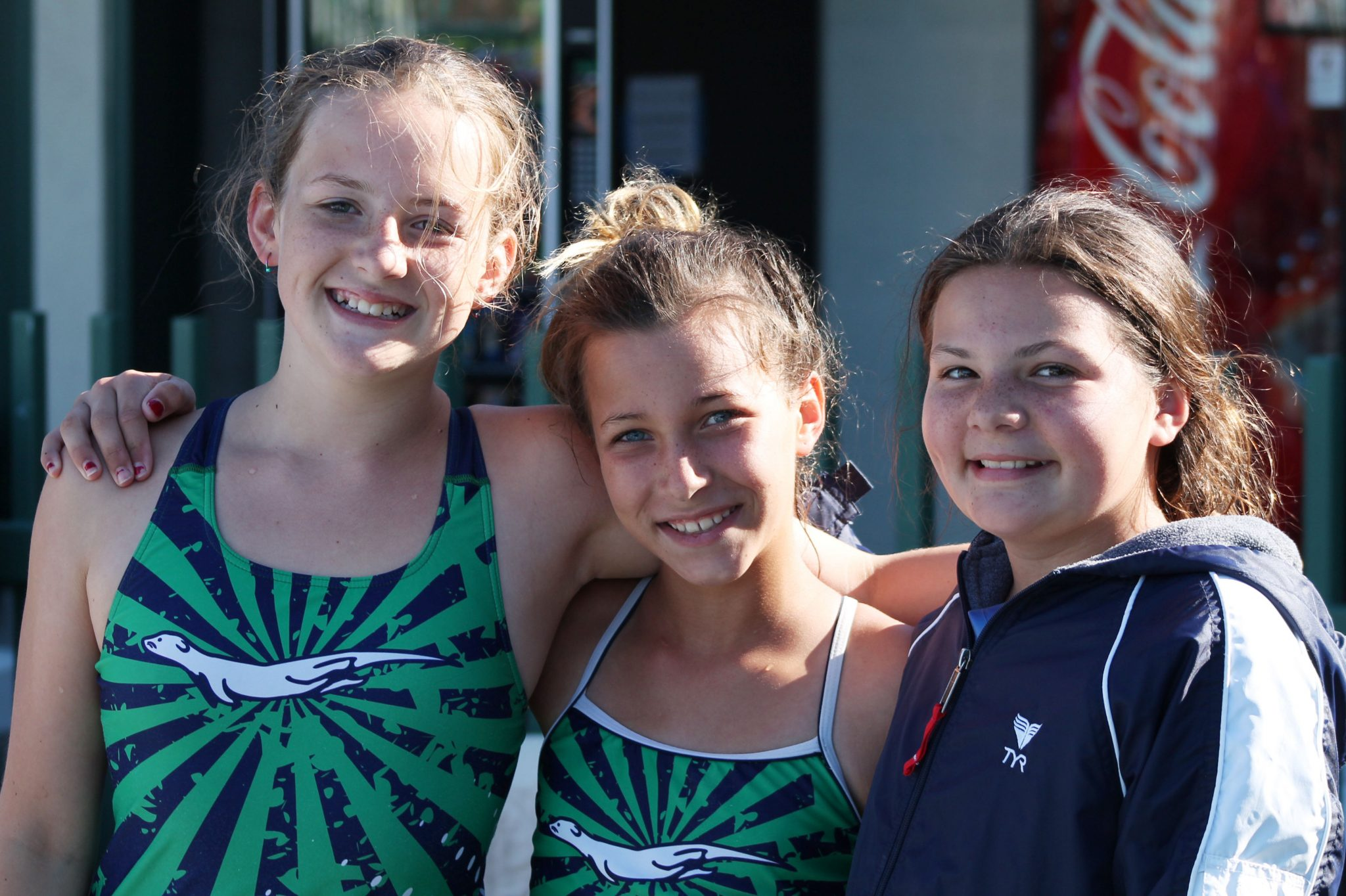 Martinez Community Swim Team members Rosie Deilke, Ariel Friedman and Grace Barnacal take a break for a picture at the Devil Mountain Pentathlon on Saturday, July 9-10, in Clayton. (TRACY PICO / Courtesy)