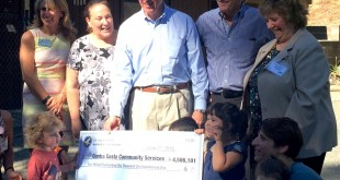 U.S. Reps Mike Thompson (center) and Mark DeSaulnier (fourth from left) present a $4.5 million check at Martinez Early Childhood Center Monday, June 27, 2016. (COURTESY / On File)