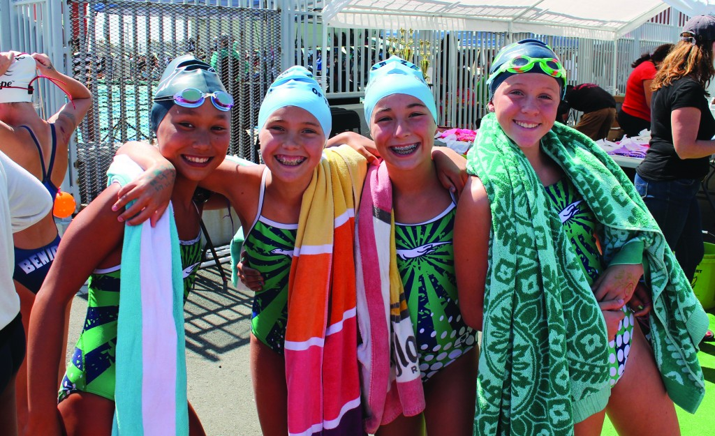 Martinez Community Swim Team Otter swimmers Casey Concepcion, Sara Cutright, Kenzie Kirshen and Tatum Cue take a break from the action. (COURTESY / On File)