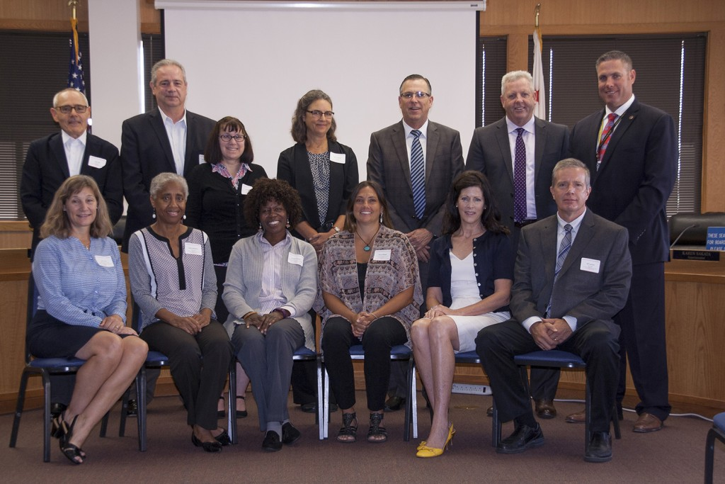 At left: The Contra Costa County Teacher of the Year Judging Panel: (back row, from left) G.J.E.L. Accident Attorneys Law Partner Luke Ellis; Chevron USA, Inc., Global Social Investment Manager Steve Woodhead; Chevron USA, Inc., Education & Corporate Programs Advisor Melissa Stone; Contra Costa County Public Defender Robin Lipetzky; Contra Costa County Superior Court Presiding Judge Hon. Steve Austin; retired Contra Costa County Superior Court Judge and current Law Partner of O'Connor, Runckel, O'Malley Hon. Dan O'Malley; Contra Costa County Assistant Sheriff Matthew Schuler; (seated, from left) Contra Costa Superior Court Judge Hon. Jill Fannin; Contra Costa Community College District Chancellor Dr. Helen Benjamin; 2017 Contra Costa Community College Teacher of the Year Professor Aminta Mickles; 2013 Contra Costa County Teacher of the Year Dr. Rona Zollinger; Contra Costa County Senior Deputy District Attorney Mary Knox; and Contra Costa County Fire Protection District Fire Chief Jeff Carman. (JUNE STEPHENS, CCCOE / Courtesy)