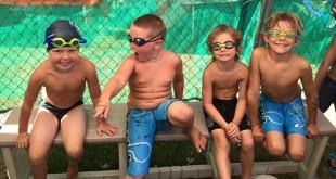 Forest Hills 6 & under swimmers Landon Floyd, Trey Carter, Wolfie Klinkner and Travis Sylvester smile for a photo. (COURTESY / On File)