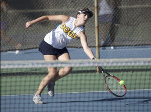 Alhambra senior Morgan Azevedo reaches out to return a shot on Sept. 12 at College Park in a match against the Falcons. (MARK FIERNER / Martinez Tribune)