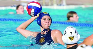 Alhambra senior Bella Hurst lines up a shot in the Bulldogs' 7-5 win over the Bishop O'Dowd Dragons on Tuesday, Sept. 6, 2016. (MARK FIERNER / Martinez Tribune)
