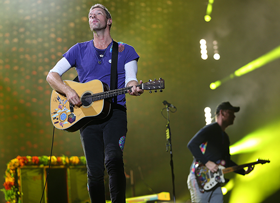 ©DANIEL GLUSKOTER Lead singer Chris Martin and bassist Guy Berryman perform during last nights Coldplay concert at Levi's Stadium.