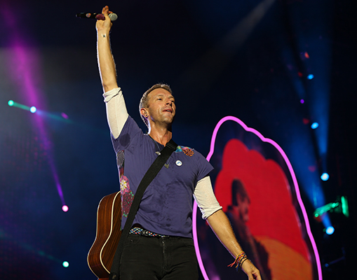 ©DANIEL GLUSKOTER Coldplay's Chris Martin salutes the crowd during last night's concert at Levi's Stadium.