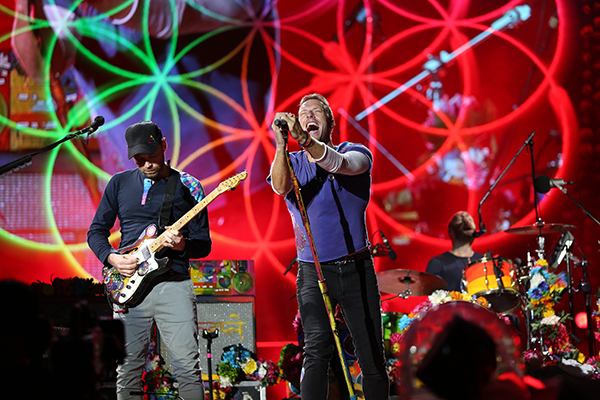 ©DANIEL GLUSKOTER Lead singer Chris Martin and guitarist Jon Buckland perform during opening moments of Coldplay's set at Levi's Stadium on Saturday.