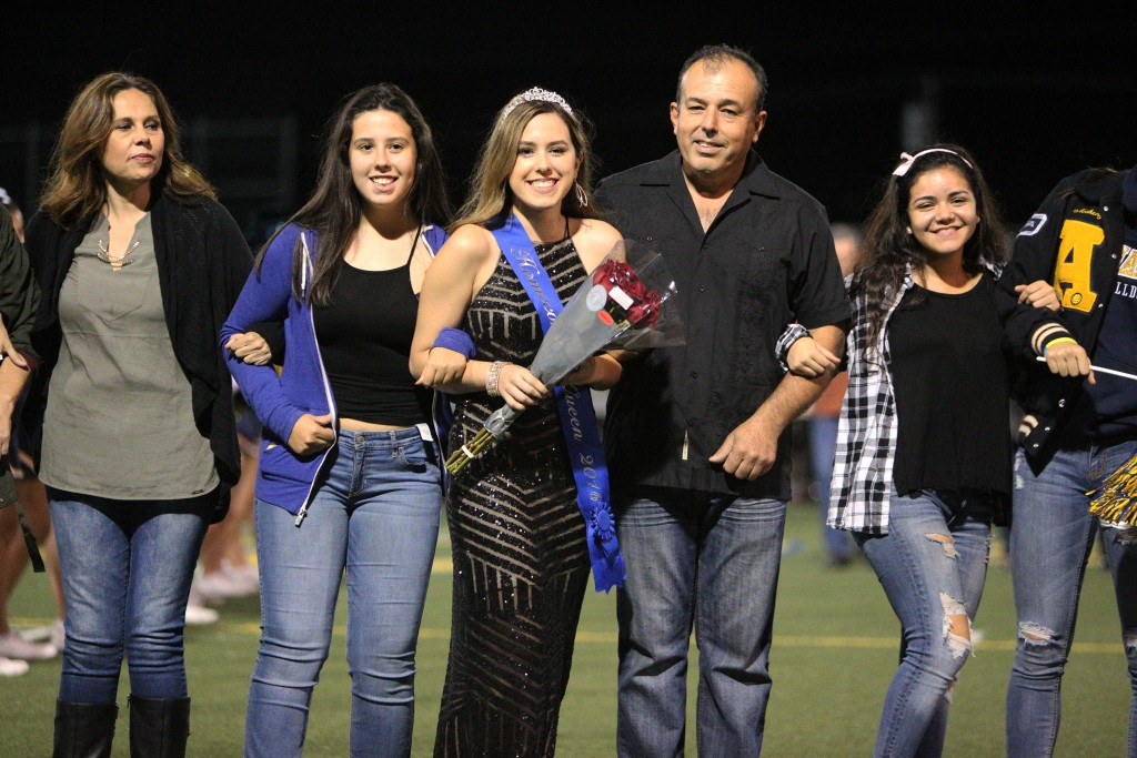 Alhambra High School's 2016 Homecoming Queen, Alexia Lopez, walks with her family during halftime at the football game at Knowles Field in Martinez, Friday, Oct. 21, 2016. (MARK FIERNER / Martinez Tribune)