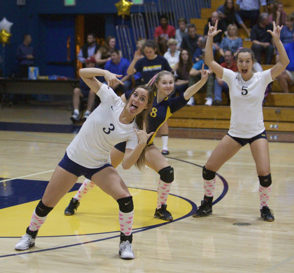 Bulldog seniors Makenzie Salva (3), Mackenzie Goulding (8), and Leslie Roofener (5) take a break from playing to celebrate during their 3-0 win over Mt. Diablo-Concord on Oct. 20, 2016. (MARK FIERNER / Martinez Tribune)