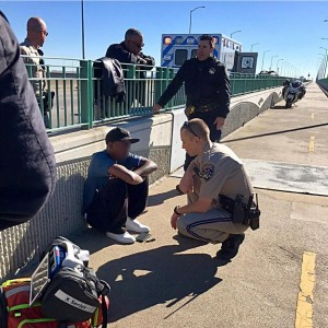 California Highway Patrolmen from Contra Costa County comfort a man after he contemplated jumping from the Benicia-Martinez Bridge Thursday morning, Nov. 17, 2016. (CHP / Courtesy)