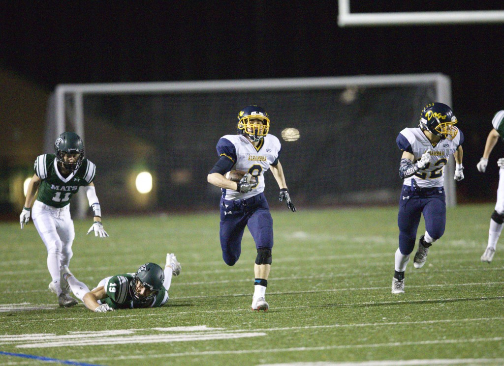 Seniors Jackson Norried (8) caught a touchdown pass after only 27 seconds of play in the Bulldogs' NCS playoff loss to Miramonte on Nov. 11, 2016. Norried and Spencer Schulhauser (22) are two of only six players who went through the program from freshmen all the way until their senior year. (MARK FIERNER / Martinez Tribune)