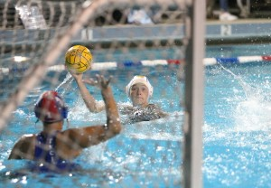 Alhambra freshman Kaylee Pond stares down on goal before converting from close range in the Bulldogs' 4-3 loss to the Encinal Jets. The game was the Bulldog coach Frank Reichert's final game as the coach of the Bulldog water polo team. (MARK FIERNER / Martinez Tribune)