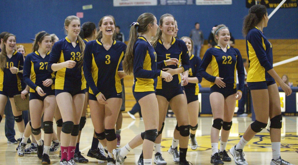 Alhambra's volleyball team was all smiles after their 3-2 win over the San Marin Mustangs in the second round of the North Coast Section playoffs on Nov. 5, 2016. The win allowed the Bulldogs to advance to the semi-finals against Marin Catholic on Nov. 9, 2016. (MARK FIERNER / Martinez Tribune)