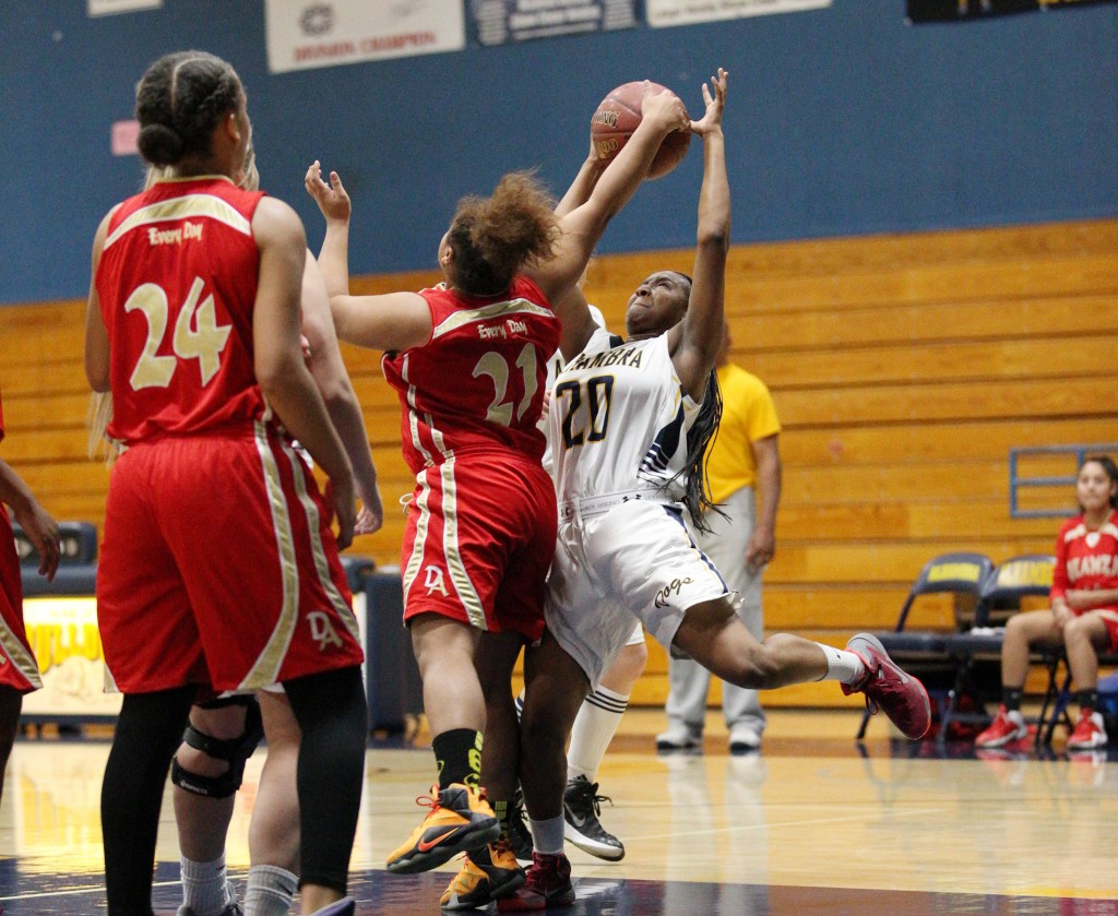 Alhambra junior Aleija Lewis draws contact in the Bulldogs' 54-30 win over De Anza on Tuesday, Dec. 20, 2016. (MARK FIERNER / Martinez Tribune)