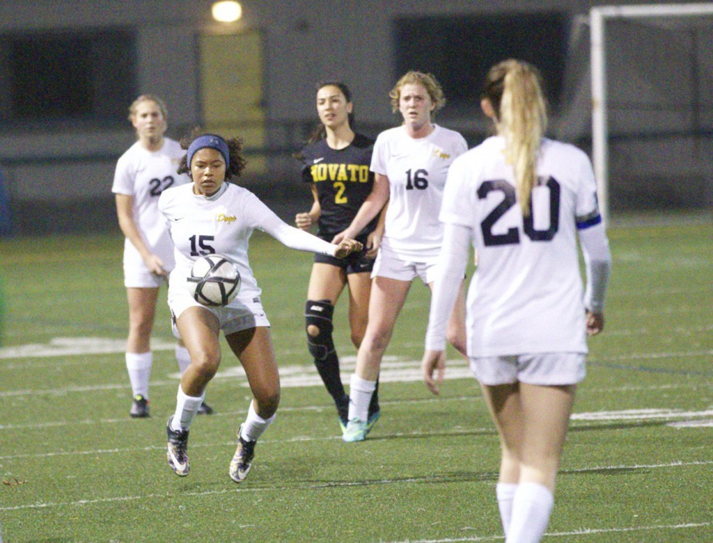 Alhambra right back Chakeira Cox (15) had an assist and played a big part in the team's second goal in the 3-0 win over Novato on Dec. 14, 2016. (MARK FIERNER / Martinez Tribune)