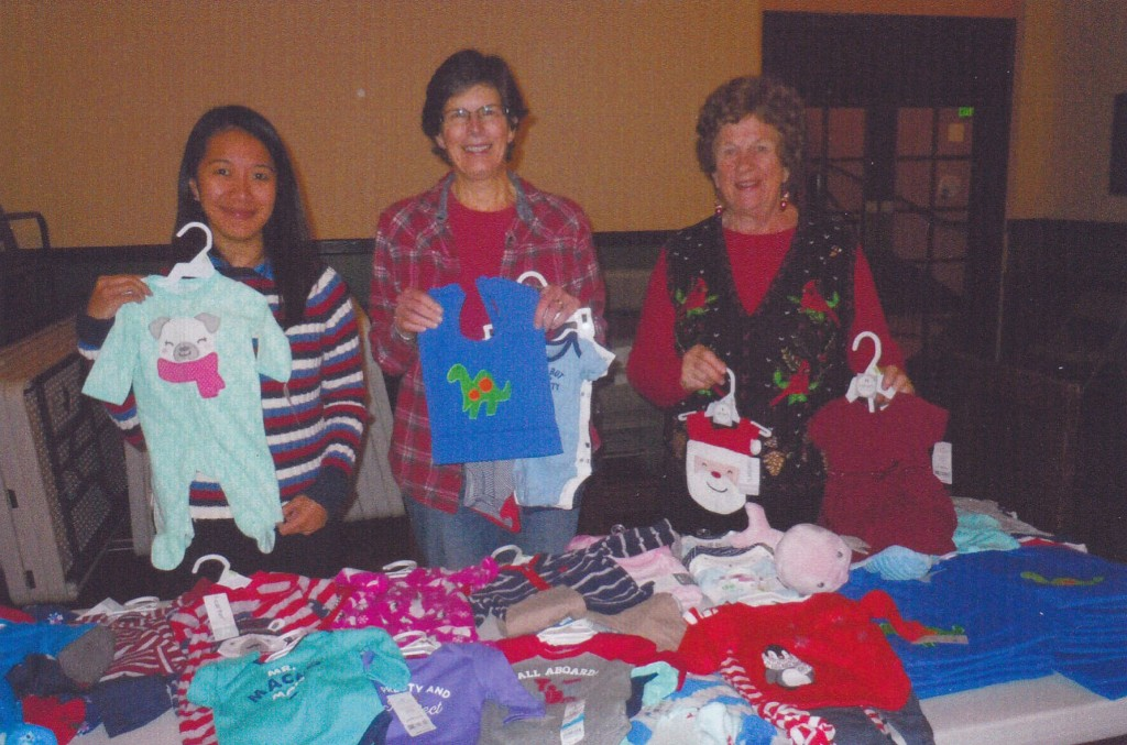 "'Crafty Ladies' affiliated with the Martinez Masonic Lodge No. 41 are Merrel Antoneo, president; Laura Conyers, incoming president; and Patricia Berringer, project chairman. They are showing items collected in their annual ""Christmas for the Babies"" for the Newborn Infant Project at Contra Costa Regional Medical Center, Martinez.  (DELORIS McDONALD / Courtesy)"