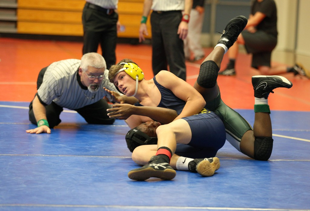 Sophomore Sam Amadeo pins his opponent in the Novice Tournament on Dec. 2, 2016, at Campolindo High School. (MARK FIERNER / Martinez Tribune)
