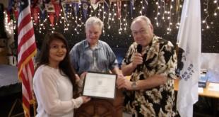 Martinez Harbor Master and Marina Manager Olivia Ortega receiving a certificate of appreciation from outgoing Flotilla Commander Bob Johnson and Martinez Yacht Club and Flotilla member Frank Kastl. (INGEMAR OLSSON / Courtesy)