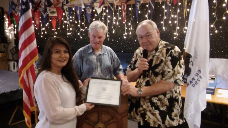 Martinez Harbor Master and Marina Manager Olivia Ortega receiving a certificate of appreciation from outgoing Flotilla Commander Bob Johnson and Martinez Yacht Club and Flotilla member Frank Kastl. (INGEMAR OLSSON / Courtesy)