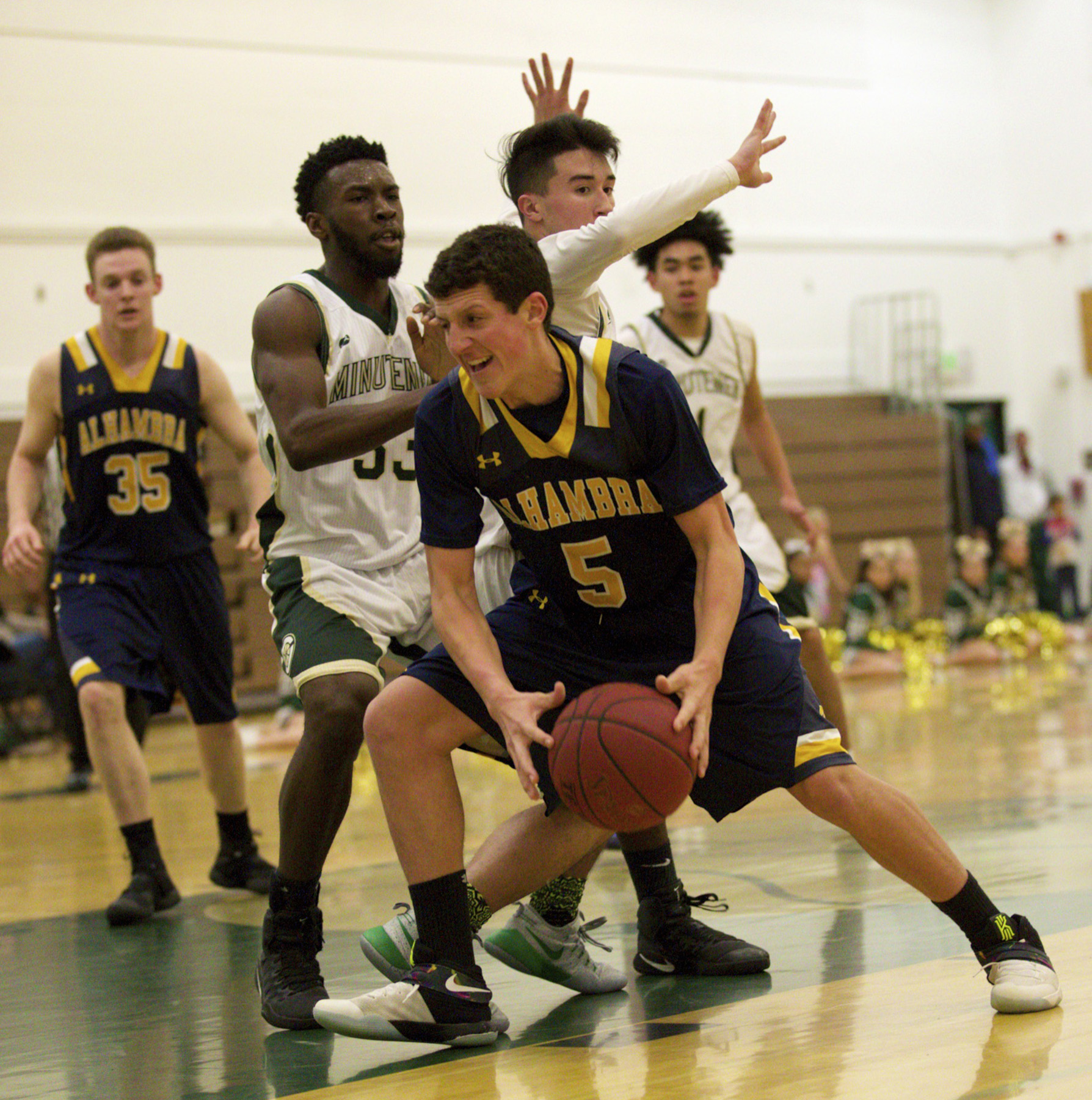 Alhambra sophomore Brody Eglite (5) pulls down a rebound and looks to get to the basket in the Bulldogs' 62-46 loss to the Concord Minutemen on Jan. 20, 2017. (MARK FIERNER / Martinez Tribune)