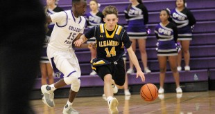 Alhambra junior Nico Martinez takes on College Park defender, junior Mekhi Dees, in the Bulldogs' 84-55 loss on the road in Pleasant Hill on Jan. 8, 2017. (MARK FIERNER / Martinez Tribune)
