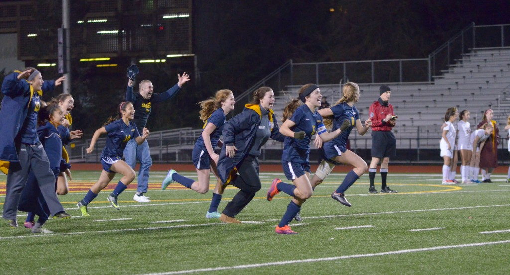 The Alhambra girls varsity team and coaches rush the field as they find themselves victorious over Las Lomas in penalties on Feb. 18, 2017. (GERARDO RECINOS / Martinez Tribune)