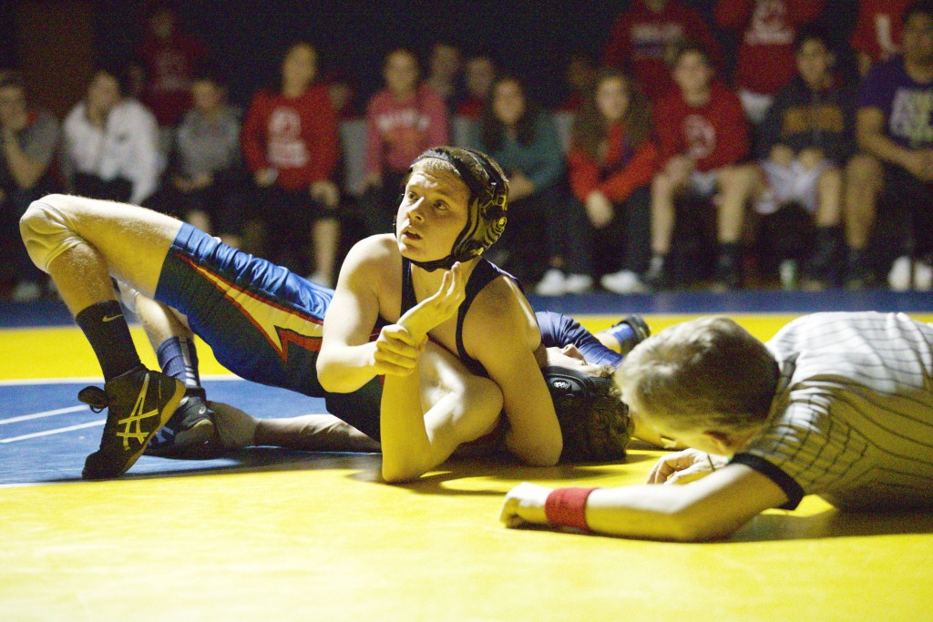 Alhambra wrestler Mikey Gargaro looks for direction from his coaches as he closes in on a pin in the Bulldogs' dual meet against Clayton Valley on Feb. 1, 2017. Gargaro won his match in the 113-pound weight class. (MARK FIERNER / Martinez Tribune)