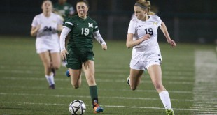 Alhambra junior Sophia Olson (right) looks to go around her defender in the Bulldogs' 1-0 loss to Miramonte on Feb. 3, 2017. (MARK FIERNER / Martinez Tribune)