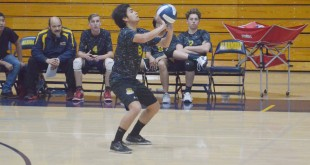 Alhambra senior Andrew Olvera is one of only two players returning to the Bulldog volleyball team after the NCS title winning season last year. Olvera and the Bulldogs lost 3-0 to Campolindo on March 7, 2017. (GERARDO RECINOS / Martinez Tribune)