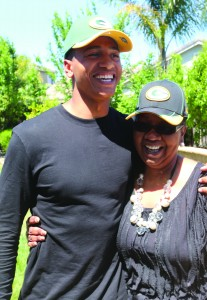 Trevor Davis (pictured above with his mother, Linda Norman-Davis) finished his regular season in Green Bay with three receptions for 24 yards and a touchdown. (ON FILE / Courtesy)