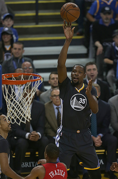 ©DANIEL GLUSKOTER Kevin Durant goes up for a shot during his return to action Saturday night at Oracle Arena. Durant scored 16 points in his first game in over a month as the Warriors stretched their winning streak to 14 games with a 123-101 victory over the New Orleans Pelicans.