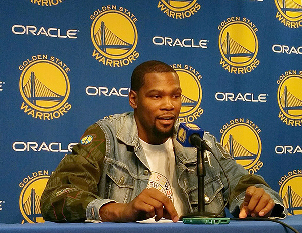 © RYAN LEONG Kevin Durant addresses the media following his first game in over a month.