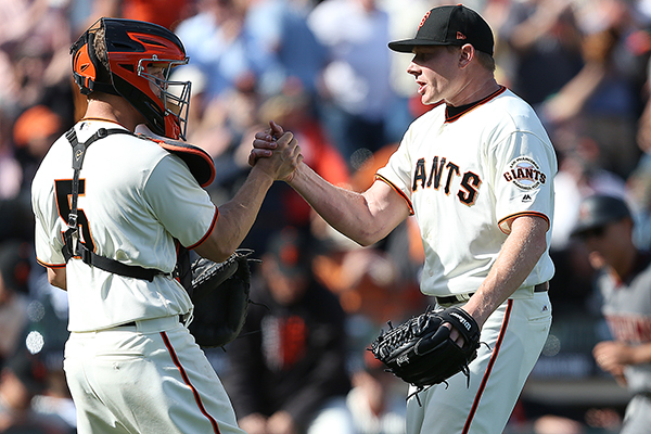 ©DANIEL GLUSKOTER New Giants closer Mark Melancon (R) is congratulated by catcher Nick Hundley after the final out of the Giants 4-1 win Monday in their home opener.
