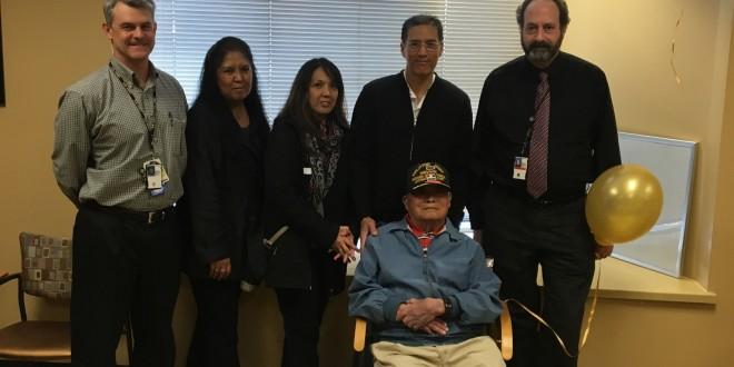 Ramon Regalado (seated), a survivor of the Bataan Death March during World War II, turned 100 last week. He is pictured here with family, friends and physicians from the Martinez Veterans Association, who surprised Regalado with a birthday party at the local VA. (COURTESY / On File)
