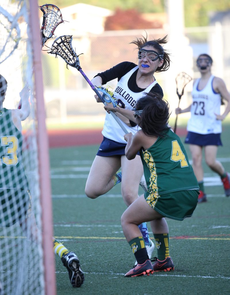 Alhambr's Emily Ramos fires a shot past the Livermore goalkeeper in the Bulldogs' 11-5 victory over their opponents on May 3, 2017. (MARK FIERNER / Martinez Tribune)