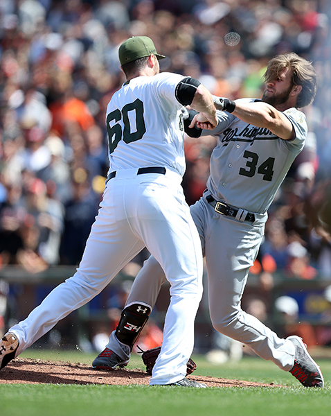 ©DANIEL GLUSKOTER Washington Nationals outfielder Bryce Harper (34) and San Francisco Giants relief pitcher Hunter Strickland brawl after Harper was hit by a pitch during action in a Major League Baseball game at AT&T Park in San Francisco, CA. The Nationals won 3-0.