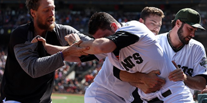 29 May 2017: San Francisco Giants relief pitcher Hunter Strickland needs to be physically restrained to be removed from the field by teammates Hunter Pence (L) and George Kontos (R) after igniting a heated brawl with the Washington Nationals as a result of hitting Bryce Harper with a pitch during action in a Major League Baseball game against the Giants at AT&T Park in San Francisco, CA. The Nationals won 3-0. (Photograph by Daniel Gluskoter/Icon Sportswire)