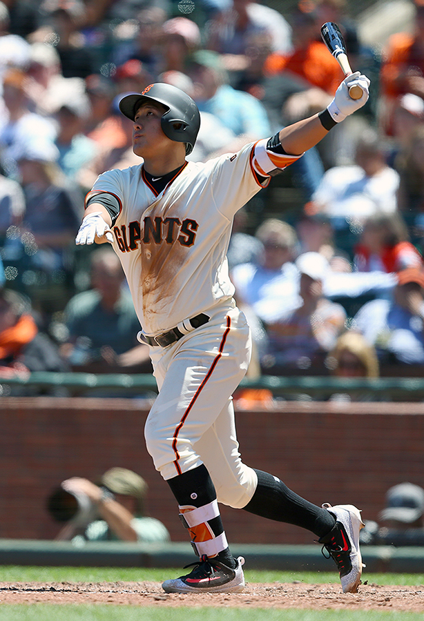 ©DANIEL GLUSKOTER Giants rookie Jae-Gyun Kwang connects for a sixth inning home run in his Major League debut to help the Giants to a 5-3 win over the Colorado Rockies at AT&T Park on Wednesday.