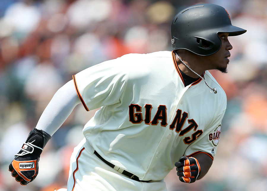 ©DANIEL GLUSKOTER Carlos Moncref's eight inning sacrifice fly RBI gave the Giants a much needed insurance run as they held on to beat Milwaukee 4-2.