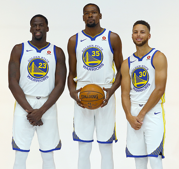 ©DANIEL GLUSKOTER  Golden State Warriors stars Draymond Green (23), Kevin Durant (35) and Stephen Curry (30) got their  2017 NBA Championship rings last night, but the team suffered a 122-121 season opening loss to the Houston Rockets.