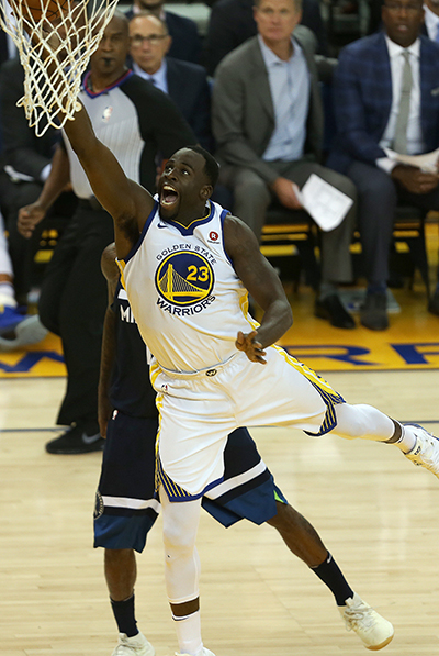 ©DANIEL GLUSKOTER Draymond Green drives to the basket during the Warriors 125-101 win over the Minnesota Timberwolves Wednesday night at Oracle Arena.