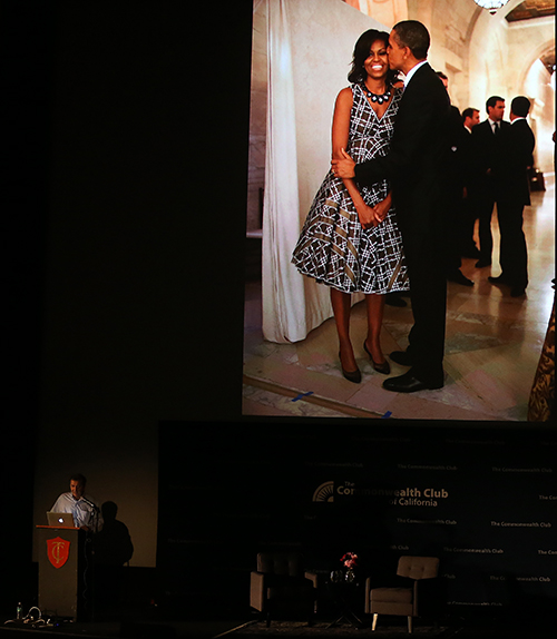 "©DANIEL GLUSKOTER Former White House photographer Pete Souza displays an image of a smiling First Lady Michelle Obama getting kissed by the President during his appearance at a Commonwealth Club event at the Castro Theatre in San Francisco Tuesday night. Souza is promoting the recent release of his coffee table book ""Obama: An Intimate Portrait."""