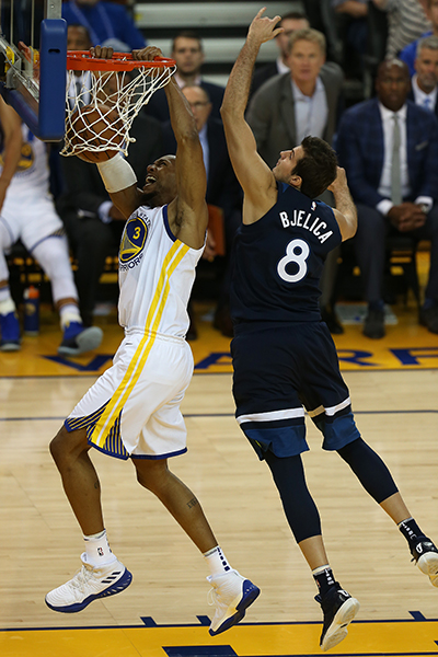 ©DANIEL GLUSKOTER David West finishes off a slam dunk in front of the  Minnesota Timberwolves Nemanja Bjelica during the Warriors win at Oracle Arena Wednesday night.