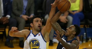 Minnesota Timberwolves guard Jeff Teague (0) puts up a shot against the defense of Zaza Pachulia (27) during an NBA game against the Golden State Warriors on November 08, 2017 at Oracle Arena in Oakland, CA. (Photo by Daniel Gluskoter)