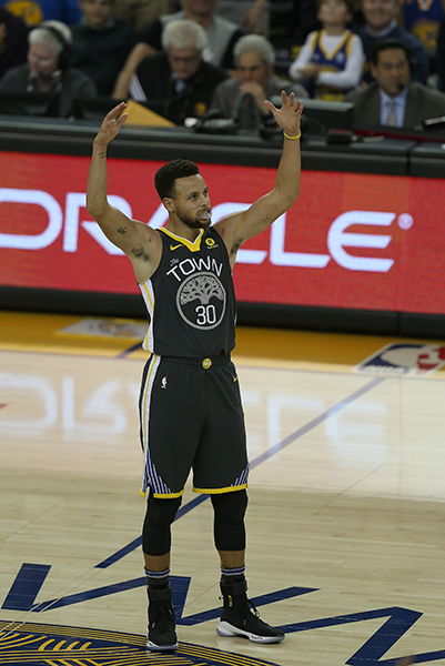 ©DANIEL GLUSKOTER Golden State's Steph Curry celebrates his 10th three point field goal of the evening, an NBA Season high, during his return to action against the Memphis Grizzlies Saturday night at Oracle Arena.