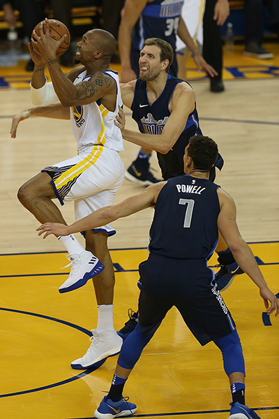 ©DANIEL GLUSKOTER David West drives to the basket around Dirk Nowitzki during the Warriors 113-97 win over the Dallas Mavericks at Oracle Thursday night.