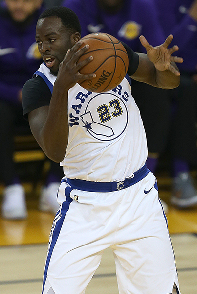 ©DANIEL GLUSKOTER Draymond Green hauls in a rebound during the Warriors win over the Lakers Friday night. Green finished with 13 points and 11 boards in his first game back from a shoulder injury.