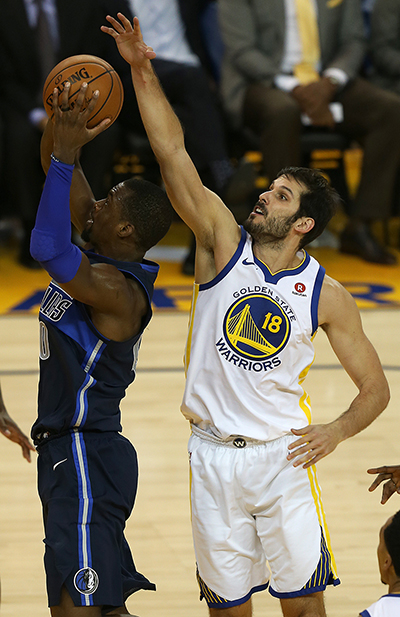 ©DANIEL GLUSKOTER Golden State's Omri Casspi goes up for a block on Harrison Barnes during the Warriors 113-97 win over the Dallas Mavericks Thursday night at Oracle.